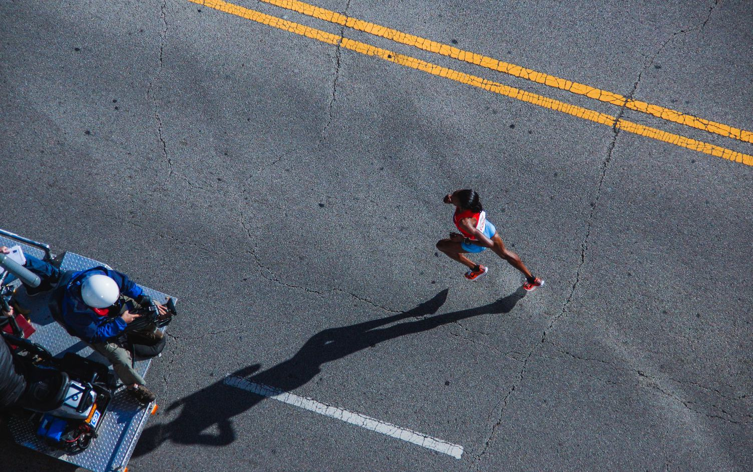 Woman Running a Marathon