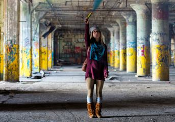 Woman Standing in an Abandoned Factory