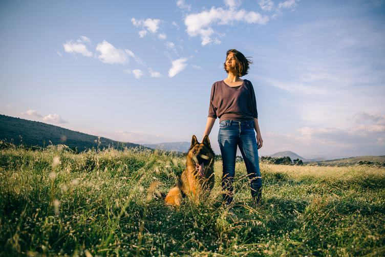 Woman Walking with her Dog German Shepherd
