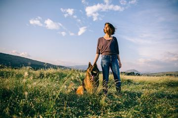 Woman Walking with her Dog German Shepherd