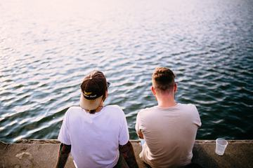Two Guys Sitting at the Wharf, Drinking, Talking and Wondering