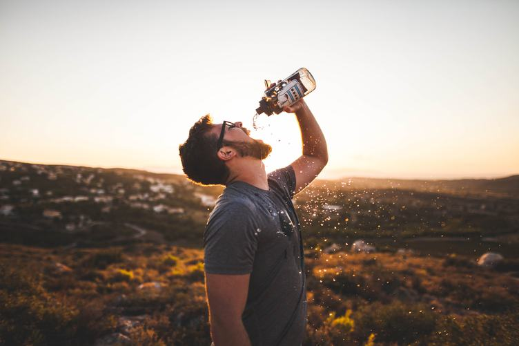 Thirsty Bearded Man Drinking and Splashing Water
