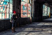 A Woman Taking a Photo in an Old Destroyed Factory