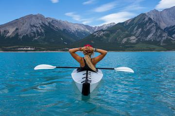 Woman in the Kayak Enjoying the View of Mountains