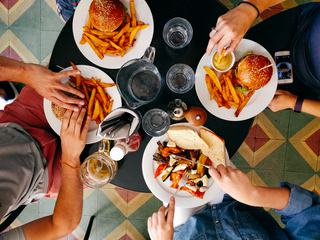 Burgers with French Fries and Grilled Vegetables with Bread