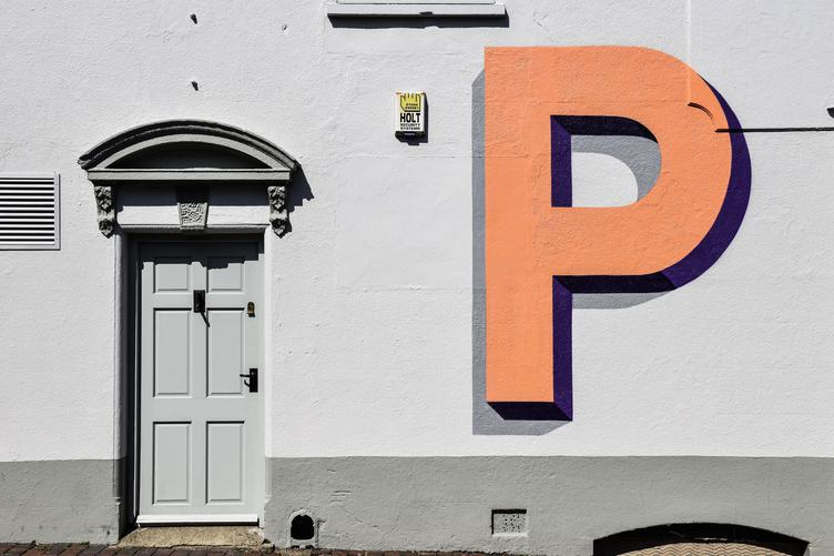Grey Wall with Orange Letter and the Grey Door