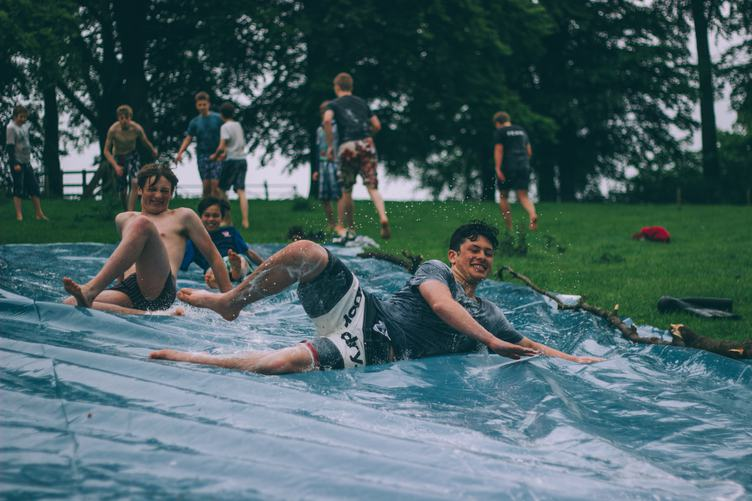 Boys Splashing Water Playing in the Park