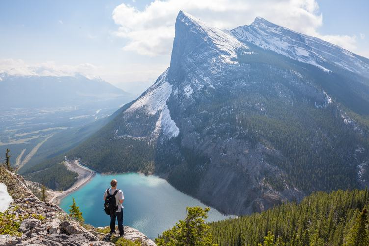 Man Looking at Snowy Peak of Mountain