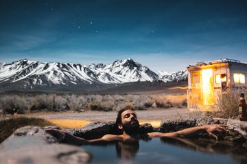 Bearded Man Relaxing and Drinking Beer in the Water