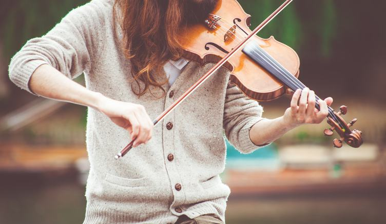 Woman Wearing Beige Sweater Playing Violin