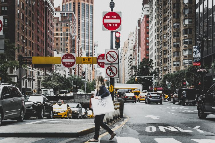 Young Woman Crossing the Street in a New York City