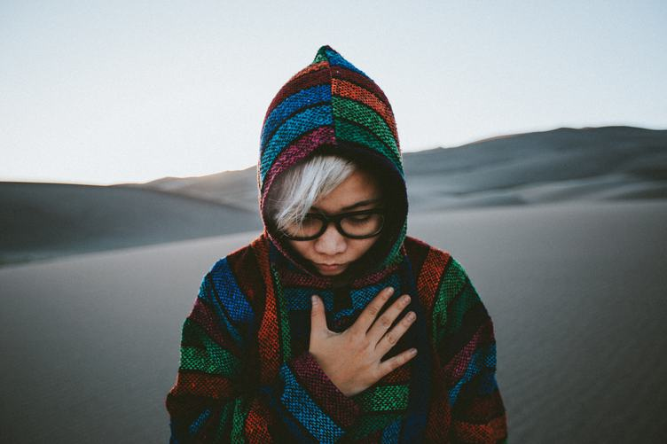 Mysterious Girl in the Hood on the Sand Dunes