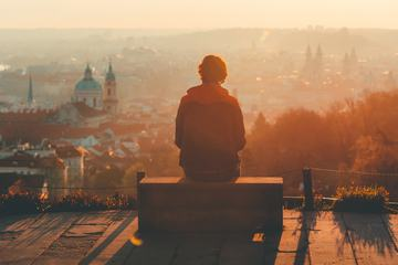 Prague in Fog, Young Man Sitting