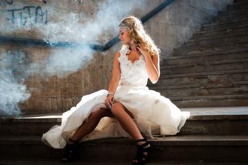 Woman Wearing White Wedding Dress Sitting on Stair