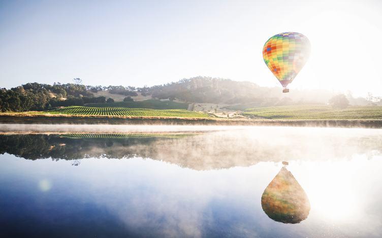 Colourful Hot Air Balloon Reflecting in a Lake