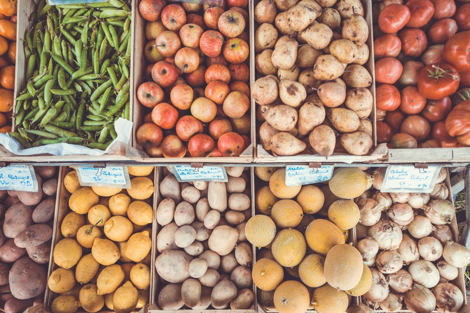 In the Marketplace Boxes with Vegetables and Fruits