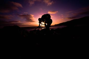 Photographer and His Camera on Tripod at Sunset.
