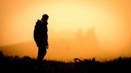Man Standing on the Orange Background