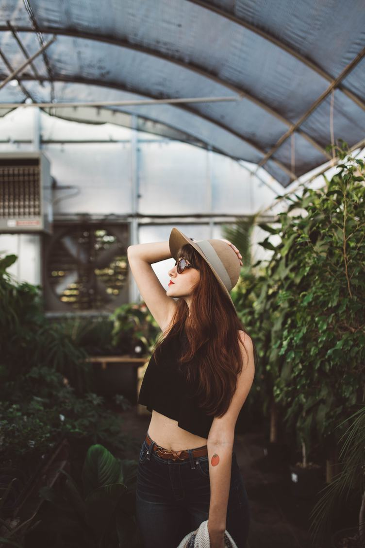 Yong Girl in the Greenhouse