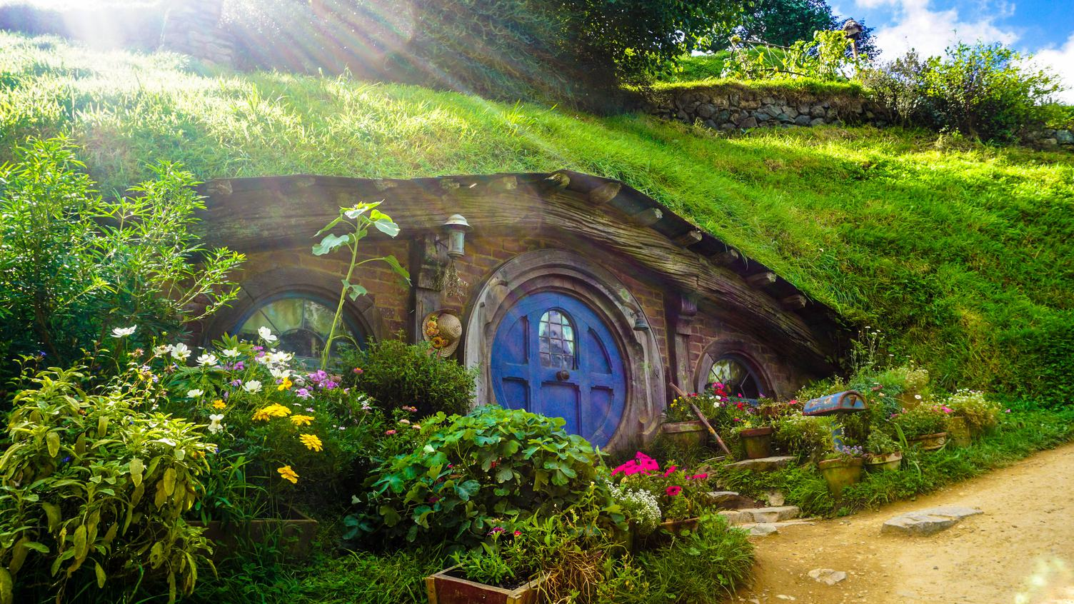 Live Like a Hobbit Small Cottage Surrounded by Greenery