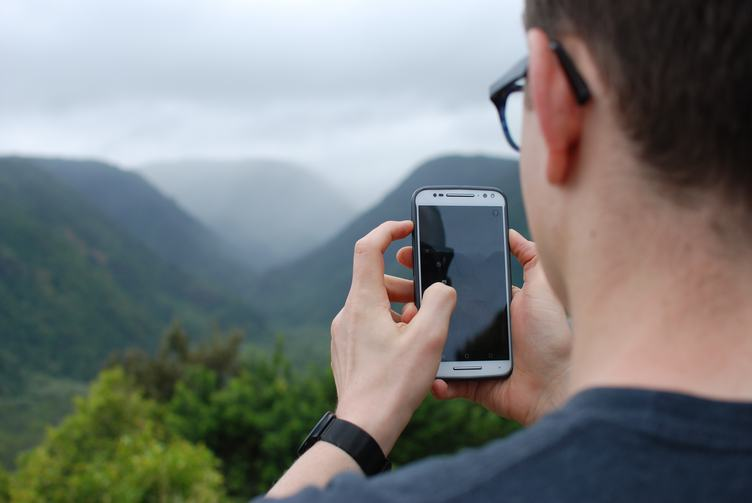 A Man Holding his Smartphone