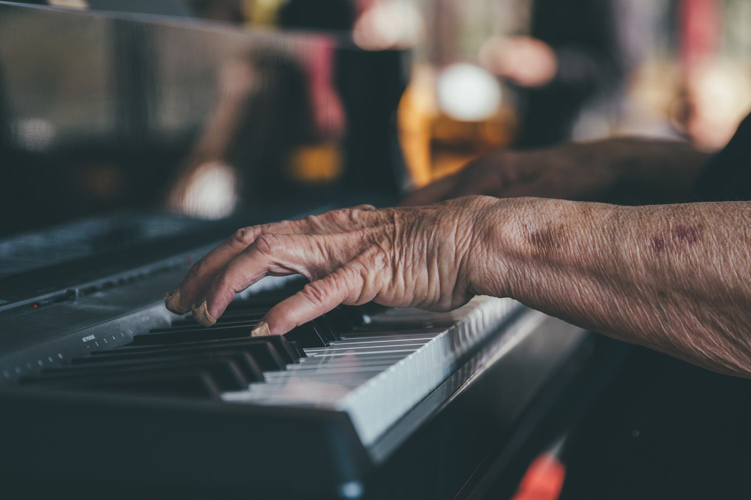 Hands of an Old Man Playing the Piano