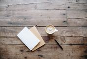 Stationary and a Cup of Cappuccino on Old Wooden Boards
