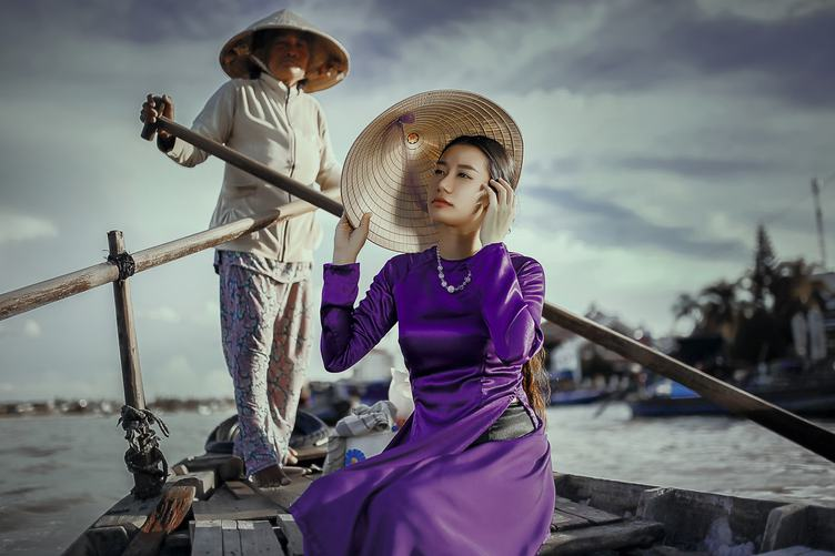 Asian Model in a Boat Wearing Conical Hat