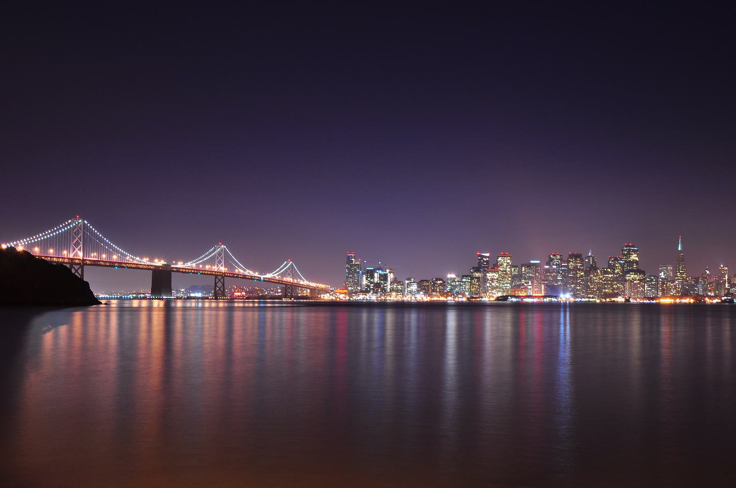 A Night View with City Lights Reflecting in a Bay
