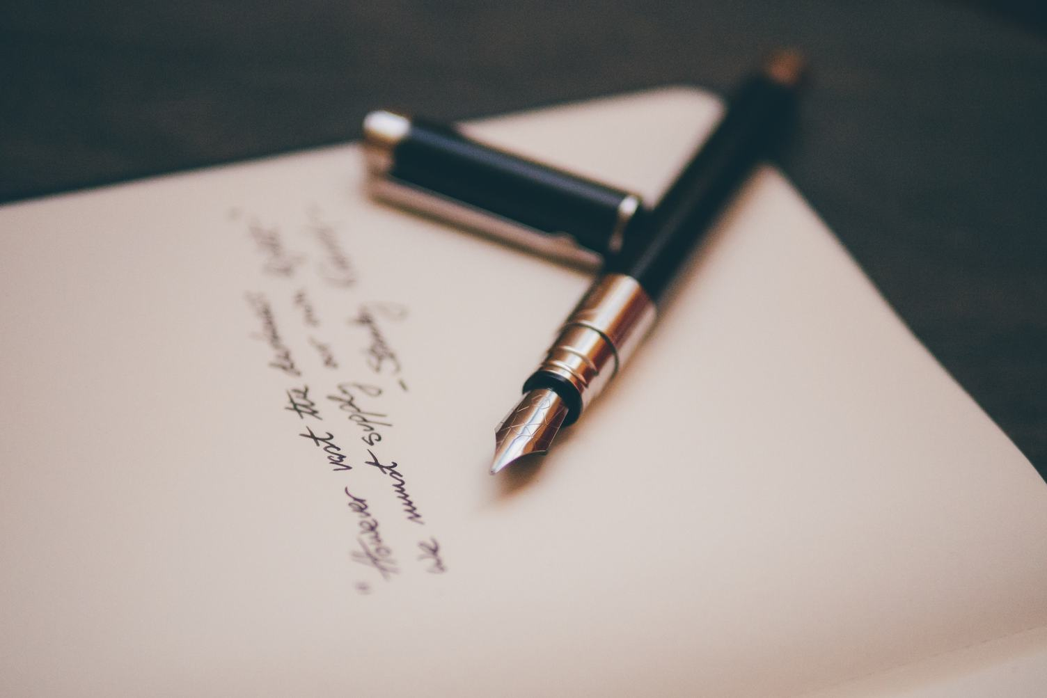 An Opened Pen with Some Handwritten Text