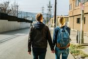 Couple Walking Holding Hands in an Urban Area