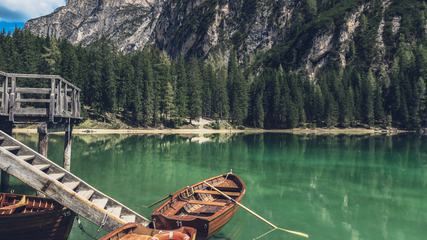 Pier and Rowboats on a Mountain Lake