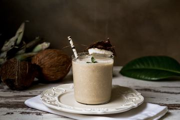Stylish Coconut Milk Beverage with a Straw