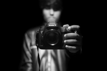 A Mirror Selfportrait of a Man Holding a Camera