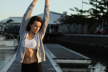 A Young Fit Woman Doing her Stretching Outdoors