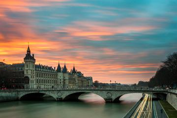 Evening View of a Parisian Bridge and Traffic Lanes along the Seine