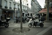 Scooters Parked on a Parisian Street