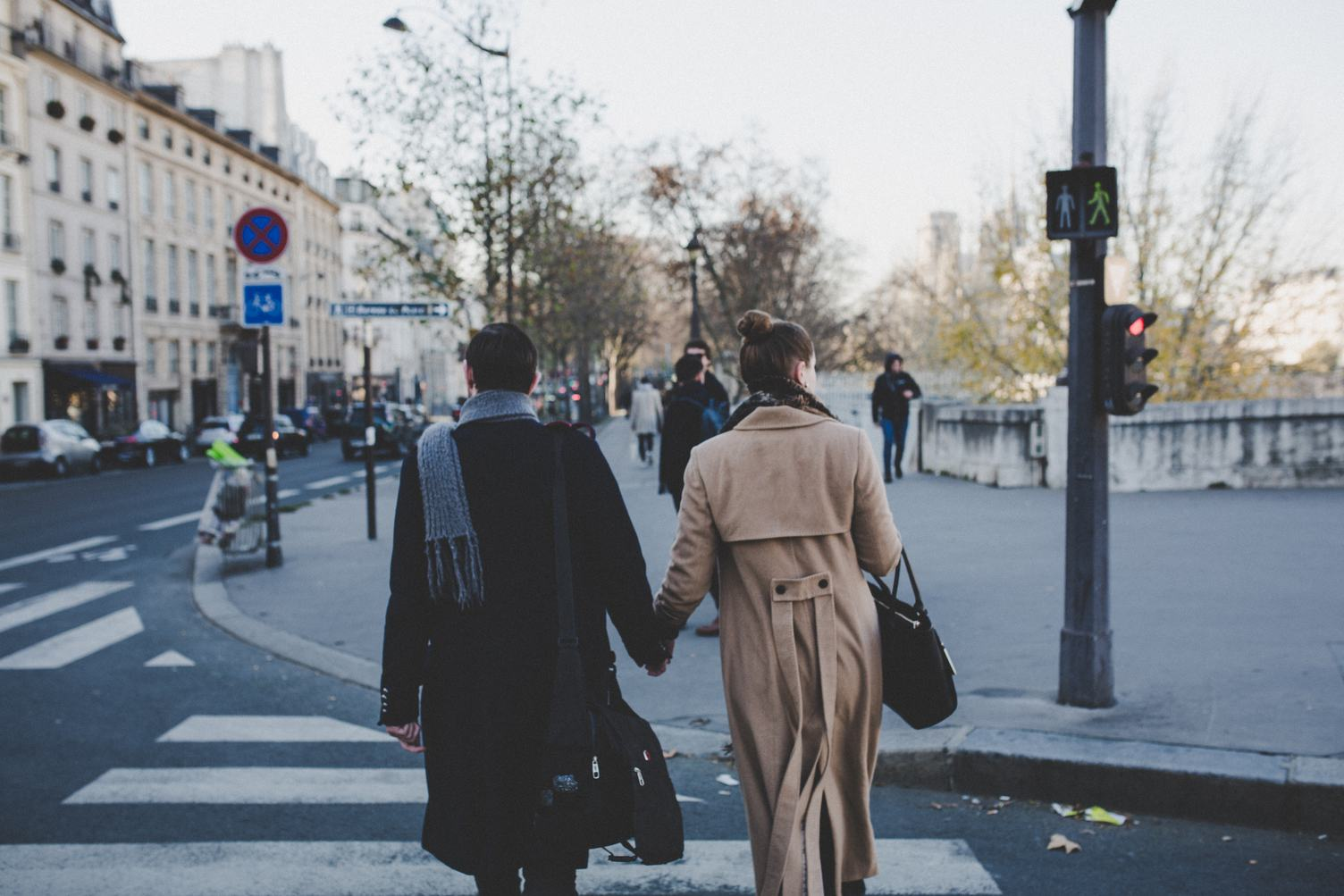 Young Couple Holding Hands Walking the Streets