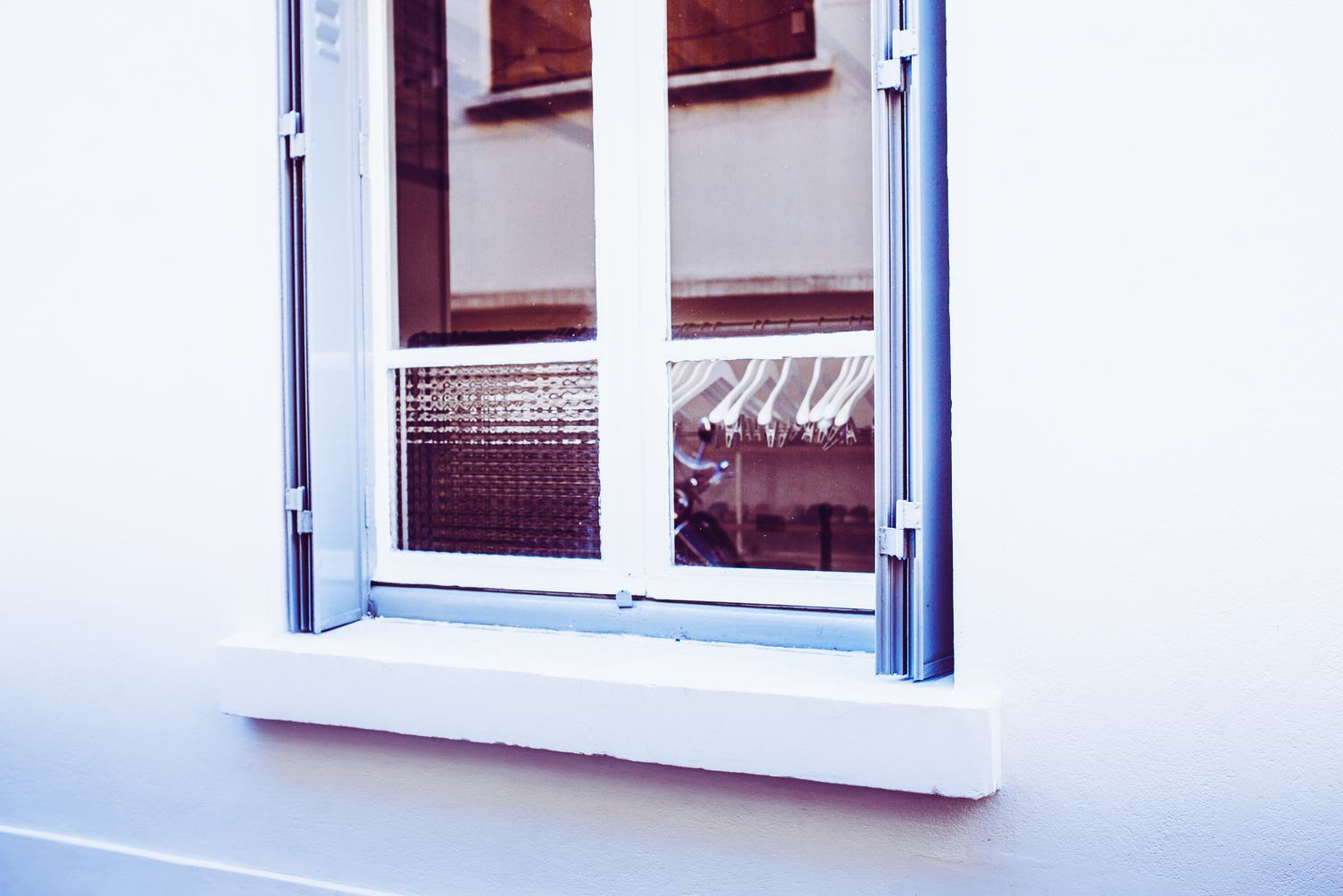 Wall with a Reflecting Wardrobe Window