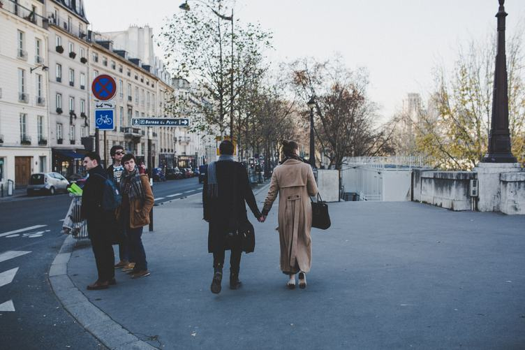 Elegant Couple Walking the Streets Holding Hands