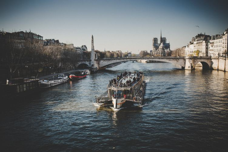Tourist Barge on the River Seine near Notre-Dame