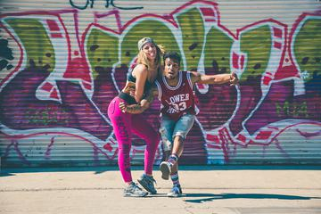Couple Fit Young People Dancing in the Street