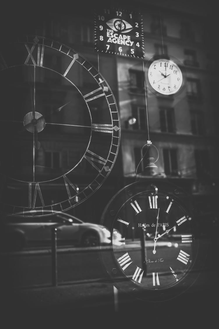 Clocks Shop Exposition Window Reflecting the Streets