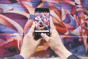 Hands Holding Smartphone Photographing Street Art