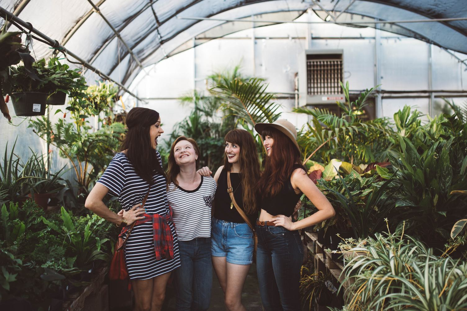 Group of Young Girls Laughing in a Greenhouse