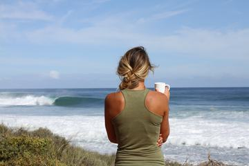 Blond Woman Looking at the Ocean Waves