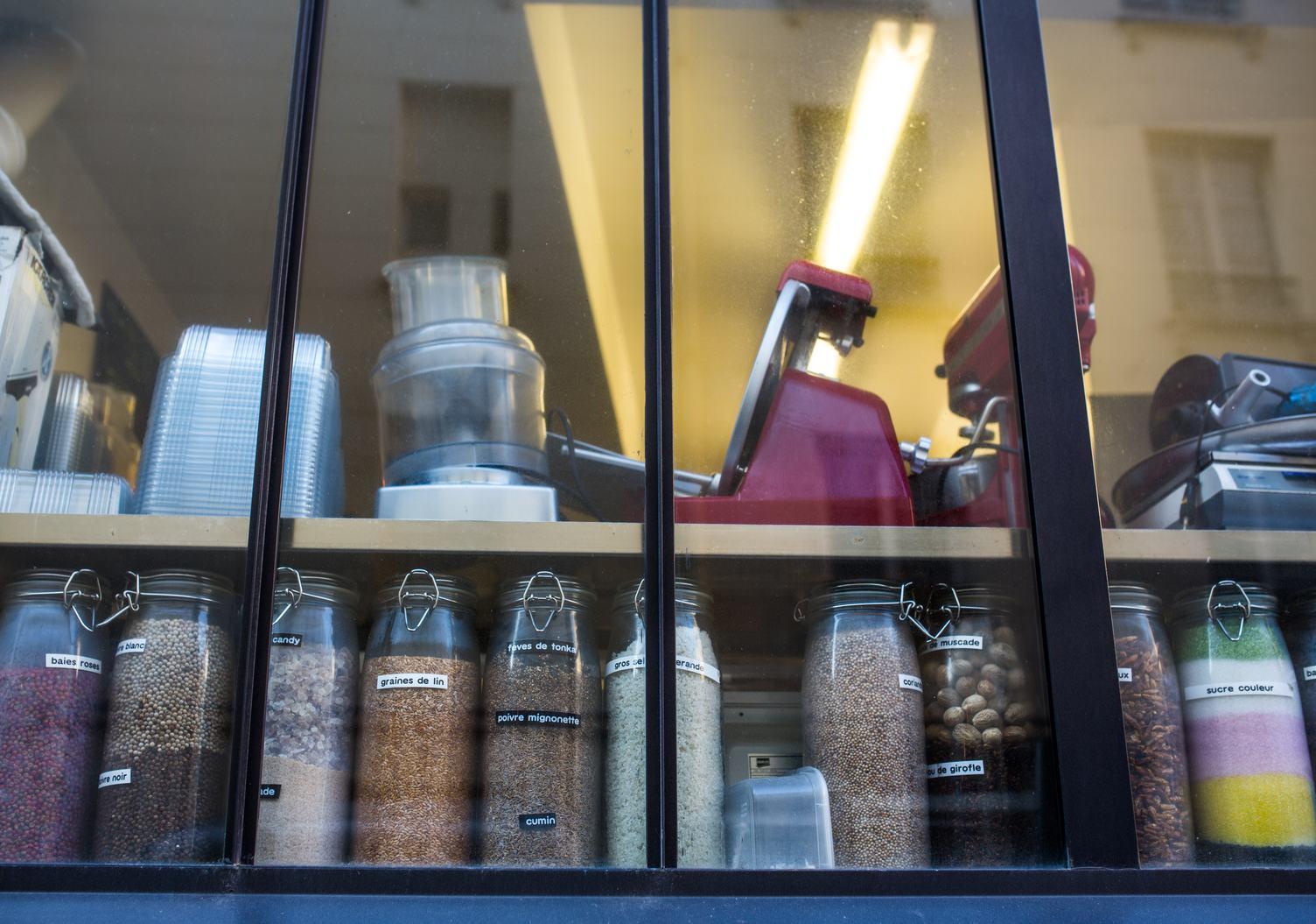 Restaurant Kitchen Window with Ingredients in Jars