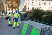 Municipal Workers Preparing Barriers and Bollards