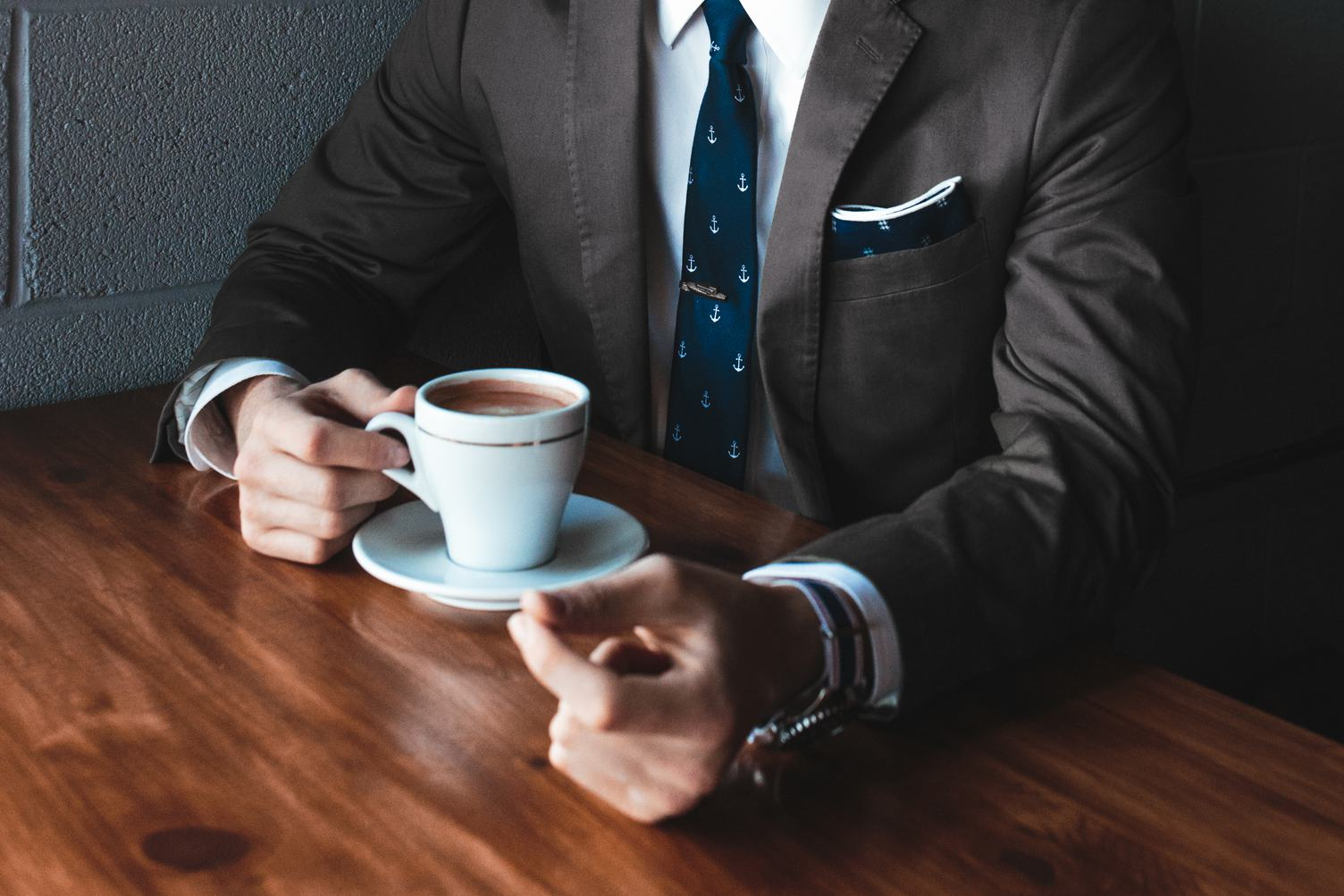 Man in a Suit Drinking Espresso