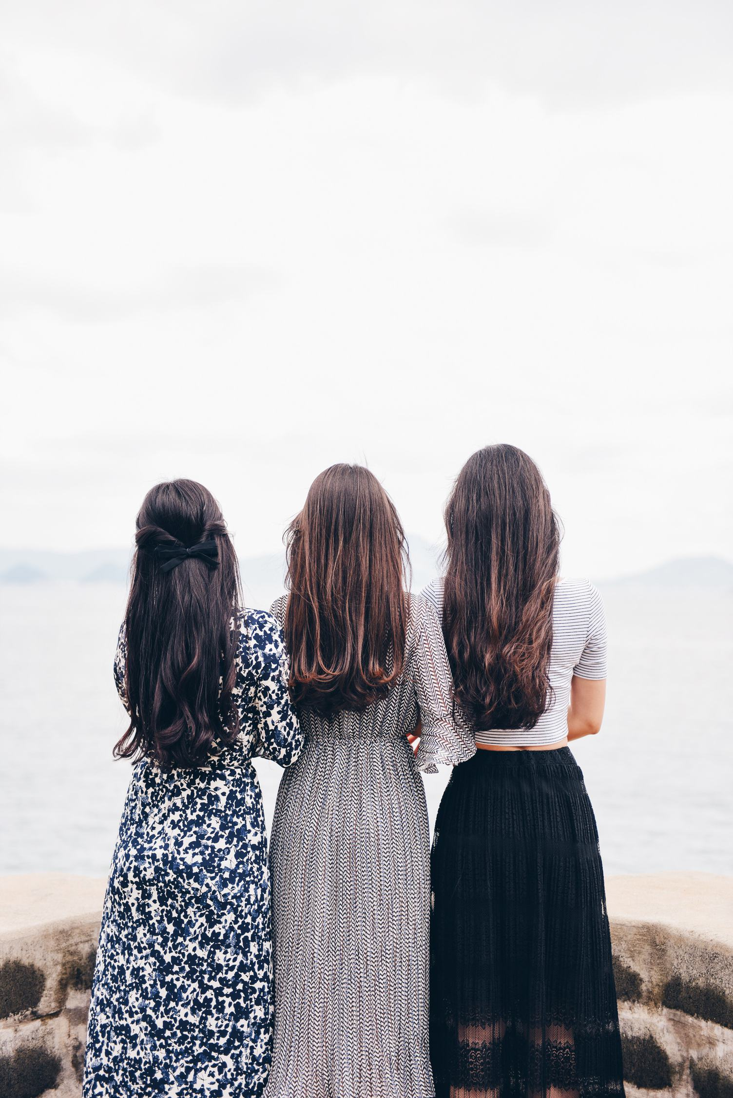Back View of Three Brunettes in Long Dresses